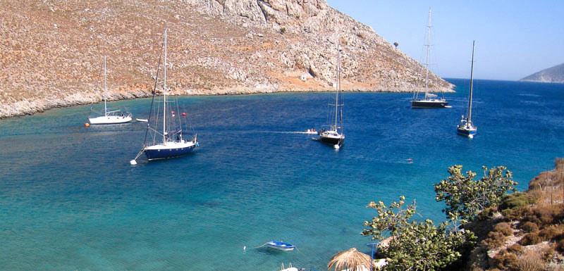 sailing boats anchored in Paleonissos, Kalymnos