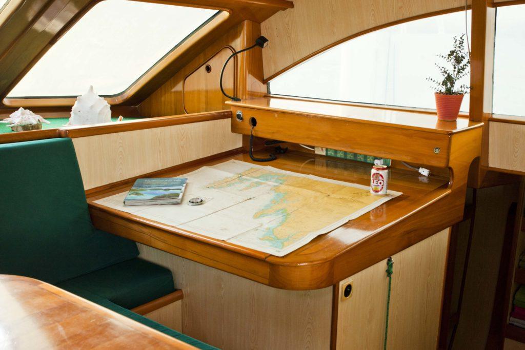 Chart table on Mahayana - cruising charter catamaran in Phuket